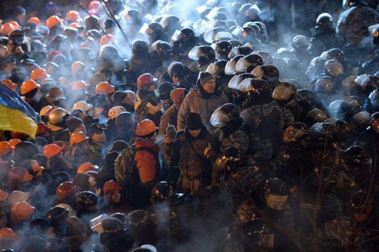 Riot policemen clash with protesters on Independence Square in Kyiv, on December 11, 2013